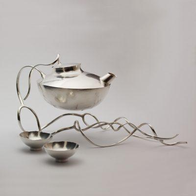 Sakekanna med koppar i silver.